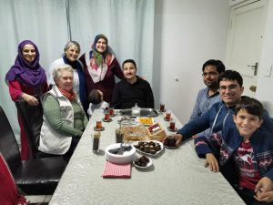 Berry Behr and Mary Frost join members of the Turquoise Harmony Institute for the Home Iftar